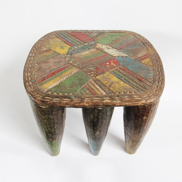 Authentic Nigerian Agaie Nupe stool. Hand carved from one solid piece of hardwood with horizontal wood grain. Traditional...