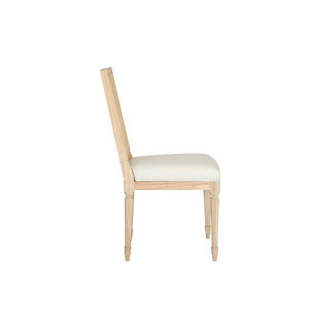 Part of Ave Home's RAW Collection, this Louis XVI style dining chair is characterized by its rectangular cane back and...