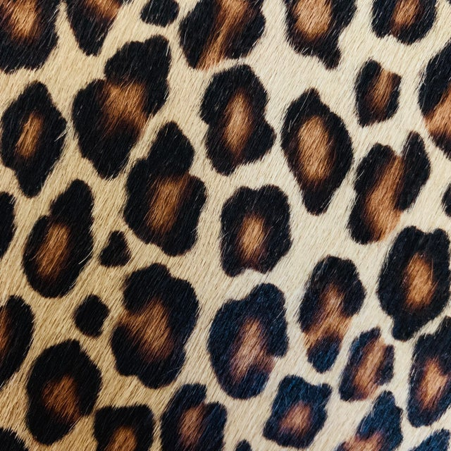 The random pattern and variegated coloring of a leopard is beautifully reproduced in this contemporary cowhide leather...