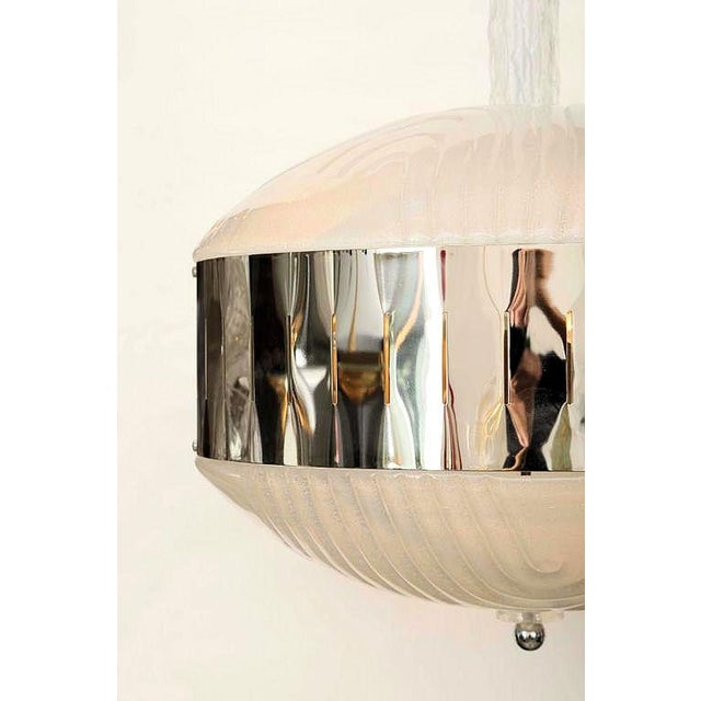 """A Murano glass """"Planet"""" shaped, pendant light or chandelier, w/ textured Murano clear translucent glass and mirrored..."""