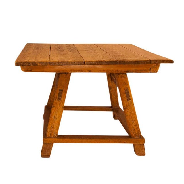 A well proportioned rustic Swiss pine farm house table, circa 1840.