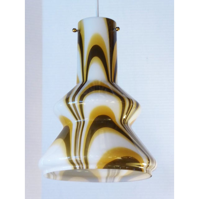 The swinging 1960s here with this blown glass pendant featuring a swirl of colors in an undulating shape. Golden yellow,...