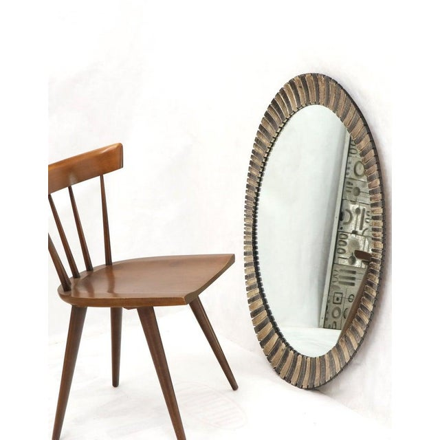 Scalloped edge Mid-Century Modern oval mirror.
