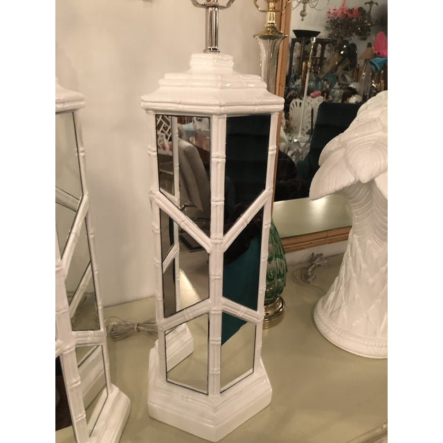 Pair of vintage faux bamboo, Chinese Chippendale, white lacquered mirrored table lamps. Newly wired, new chrome hardware....