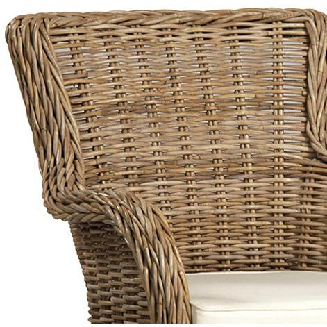 Woven rattan armchair in a natural brown/grey finish. Off-white cushion is included. This chair is meant for indoor use only.