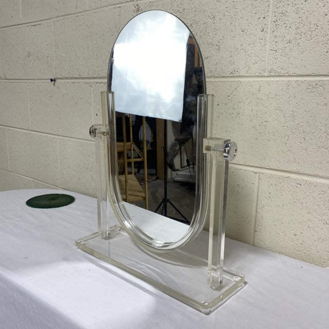 What glamour girl wouldn't be complete without a lucite vanity mirror. Double sided so you and your girlfriends can each...