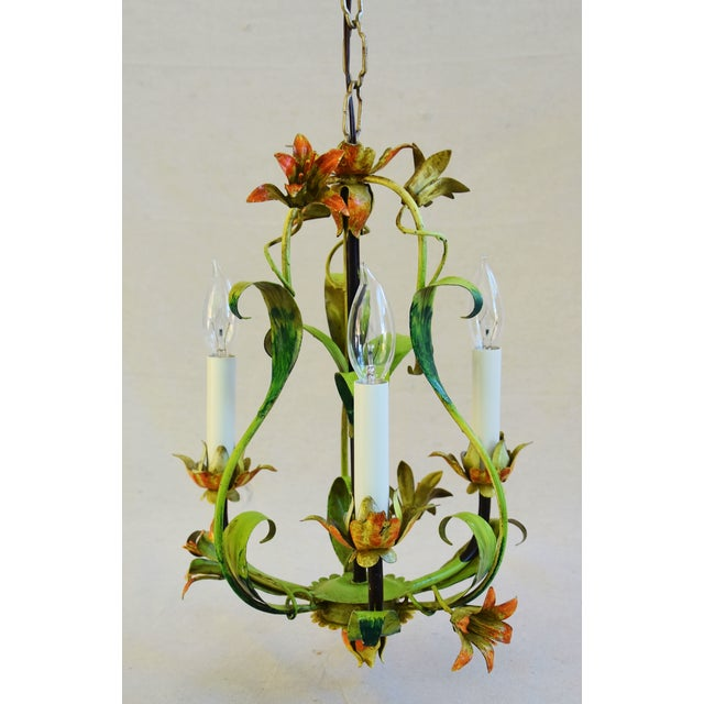 Vintage Italian tole three-arm/light chandelier with ornate scrolling leaves, scalloped bobeches, lily flowers and...