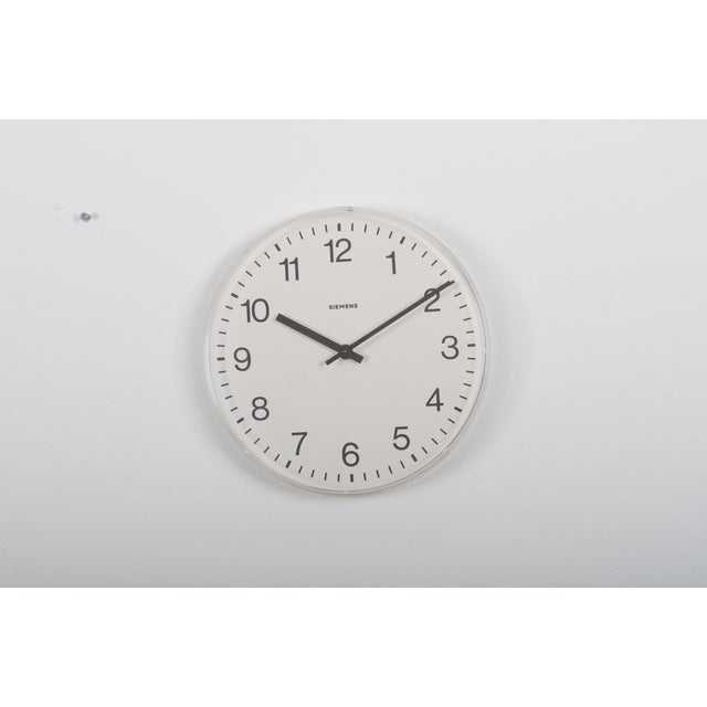 German station clock by Siemens from the late 1970s. Formerly as a slave clock with mechanical movement, it is now fitted...
