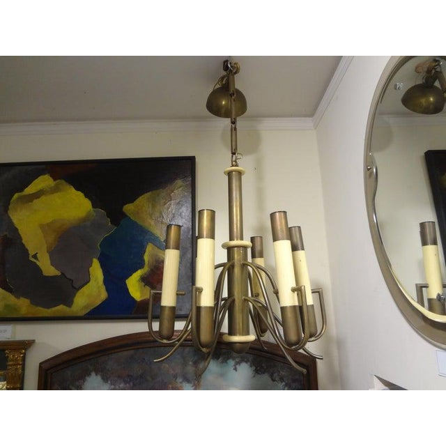 Great midcentury Italian Brutalist style brass and bakelite chandelier by Nucleo forme. This unusual Gaetano Sciolari...