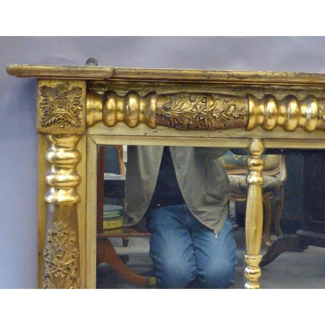 A large and beautiful gilded empire overmantle mirror all original recently removed from the house it spent most of its...