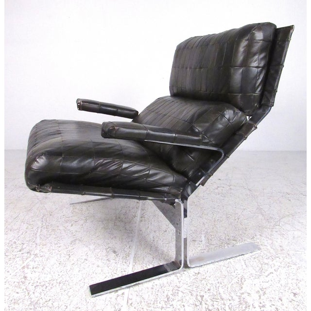 Heavy chrome frame with patchwork leather upholstery make this a very comfortable and stylish example of midcentury...