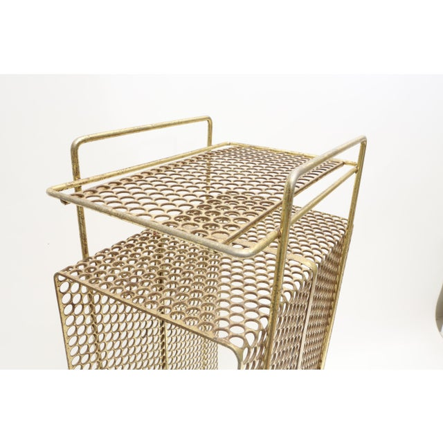Ultra cool mid century Solid Brass metal mesh magazine stand. Very heavy and sturdy and stylish piece for storing your...
