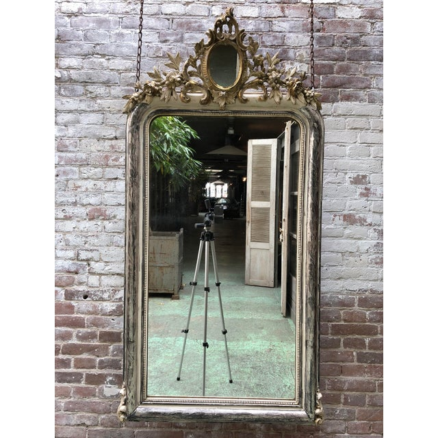 19th century mirror, silver leaf gilded in the style of Louis Philippe, Provenance France. This 19th Century Mirror is...