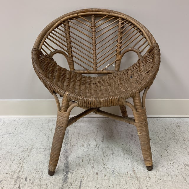 Rare to find an early 20th century piece of wicker still in original finish and in such good shape. Fun mid century vibe...