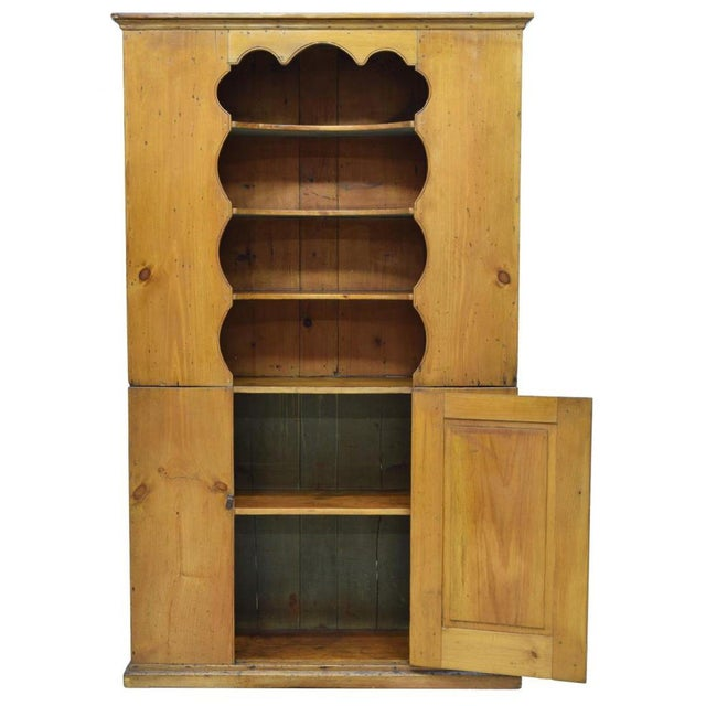 This charming New England Colonial pine pewter display cupboard was built in the late 18th c. Not only is it attractive,...
