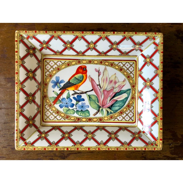 Set of three rectangular decorative plates with bird and fruit designs, made in Italy.