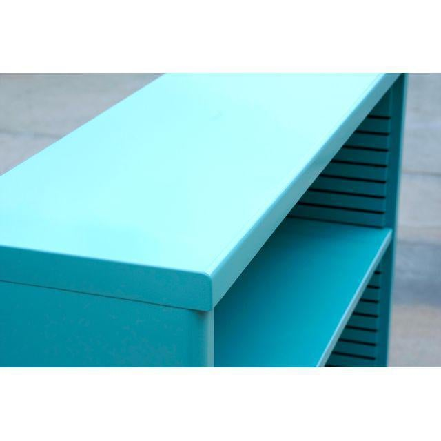 Neat 1960s tanker style steel bookcase freshly powder coated in high gloss Turquoise. Originally used in the UCLA math...