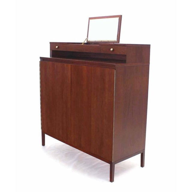 Paul McCobb high chest of drawers with lift top mirror vanity.