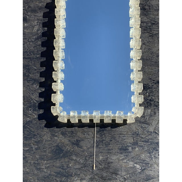 Illuminated acrylic resin mirror. Requires eight up to 40watt E14 base bulbs. On/off pull switch.