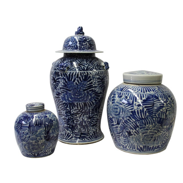 This is a handmade Chinese accent decorative blue and white porcelain temple ginger jars set. It has a temple jar and two...