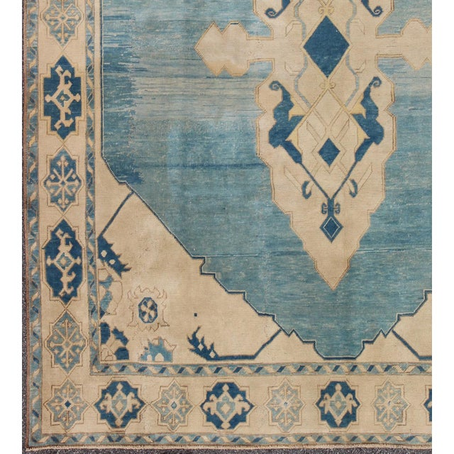 This beautiful rug from mid-20th century Turkey features a Classic Oushak design, which is enhanced by lustrous wool. The...