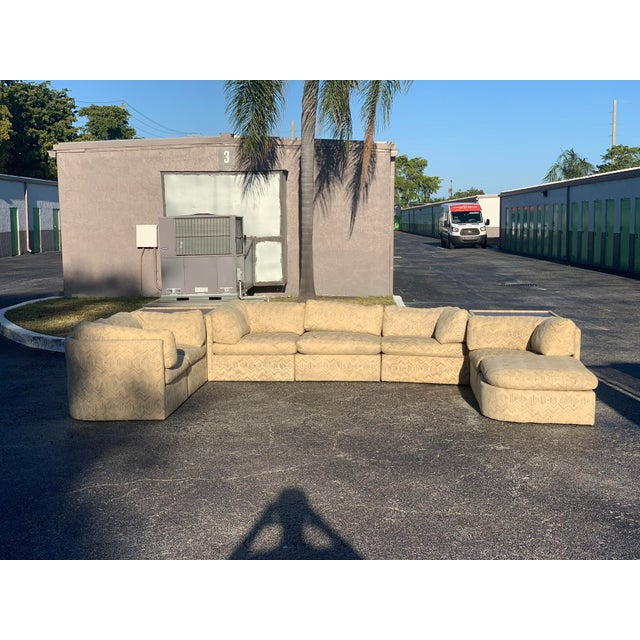 Beautiful in style and size, this Milo Baughman sectional sofa is in a class of its own. Deep and comfortable cushions...