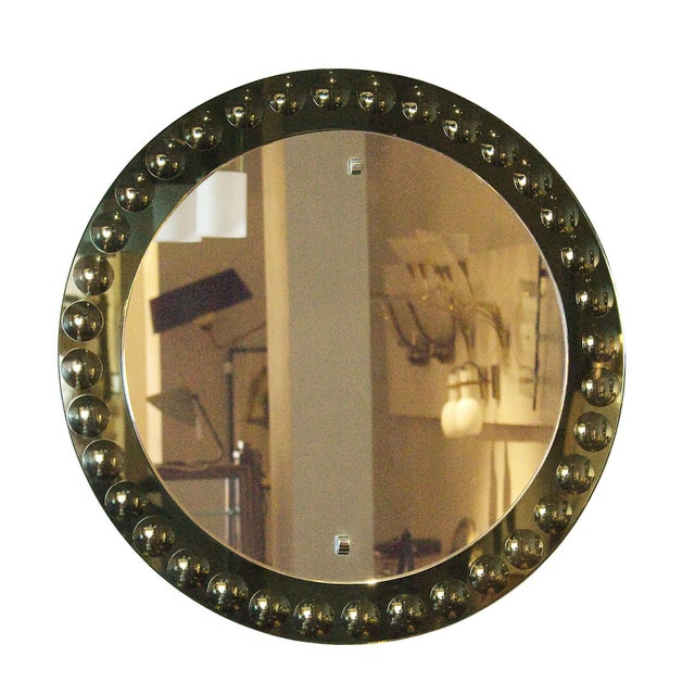 Nice round mirror, grey-green mirror frame with intaglio round decoration. Italy, circa 1950.