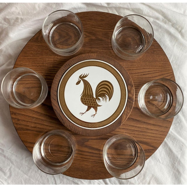 Awesome mid-century teak lazy susan with ceramic center tile featuring a golden rooster design. Included are the 6...
