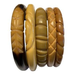 Set of Five 1940s Carved Bakelite Bangle Bracelets For Sale