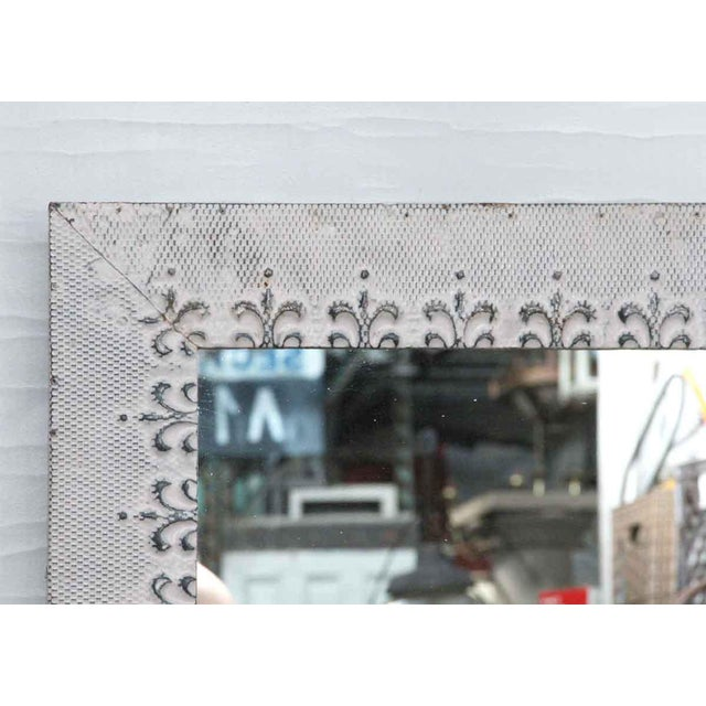 This mirror is hand crafted using antique tin ceiling tiles. It is ready to ship. The dimensions are 35 in. H x 46.75 in....