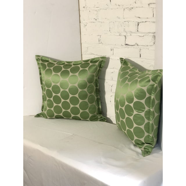 Fabulous pair of flange edge square throw pillows with rich green circles on a champagne colored background. The geometric...