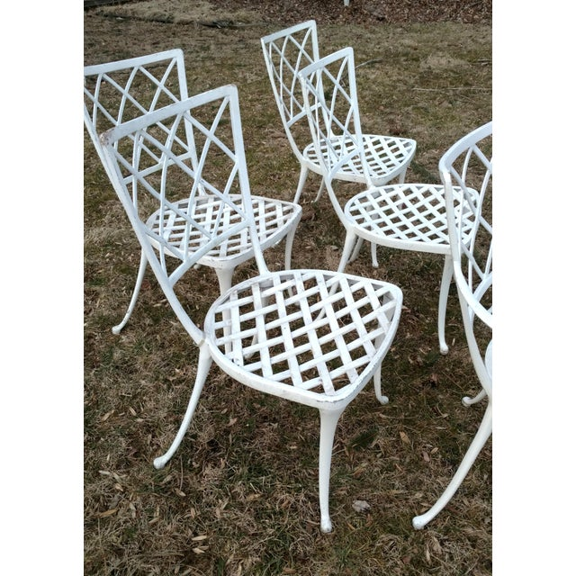 Brown Jordan cast aluminum white patio chair set, 6 Criss cross back pattern, gracefully bowed legs. Matte white finish....