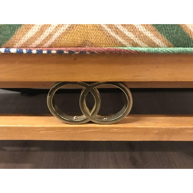 James Mont Style long bench with brass ring detail. Newly upholstered in Osborne and Little fabric. Perfect at the foot of...