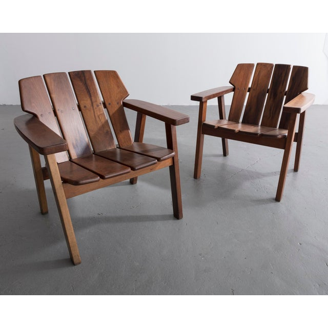 Pair of slatted rosewood lounge chairs. Designed by Sergio Rodrigues, Brazil, 1960s.