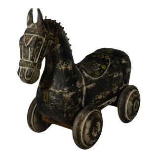 Vintage Indian Hand Carved Wooden Horse With Wheels and Iron Features For Sale