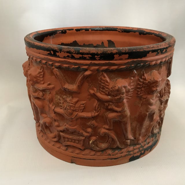 Antique terracotta pot with putti relief decoration and incredible glaze patina.