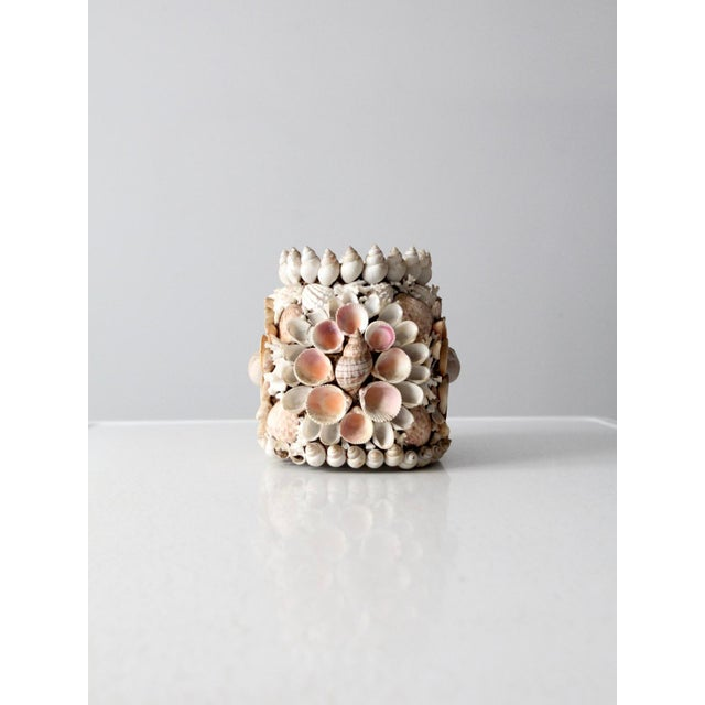 This is a vintage shell vase circa 1930. Beautifully arranged seashells and coral cover a Hazel Atlas jar to shape this...