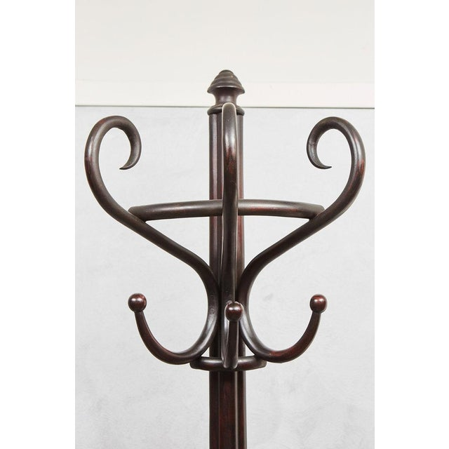 This nice English Bentwood Hat Rack with three legs is made to stand against the wall, a wonderful design feature that we...