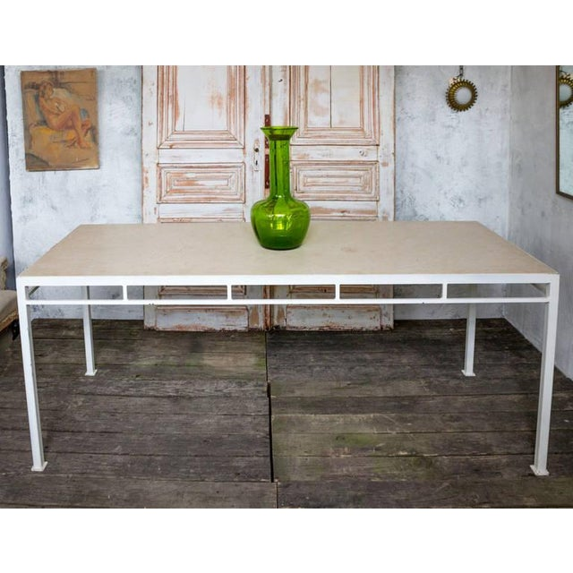 Newly made dining table from the Reeditions' Marcelo Series. As shown, white paint finish on iron with a limestone...