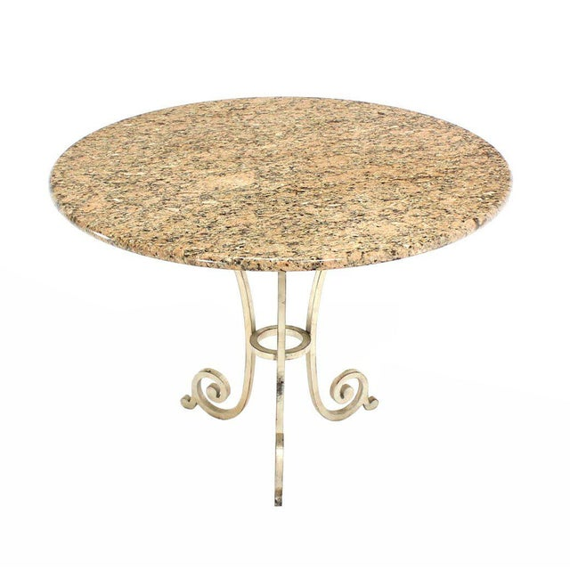 Nice heavy iron base thick granite top guardian or center table.