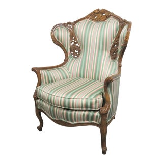 Louis XV Style Musical Motif Carved Wing Chair For Sale