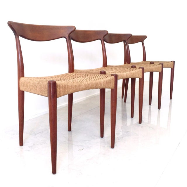 A fantastik set of four Arne Hovmand Olsen Danish teak classics! Highly sculpted solid teak frame and back with danish...