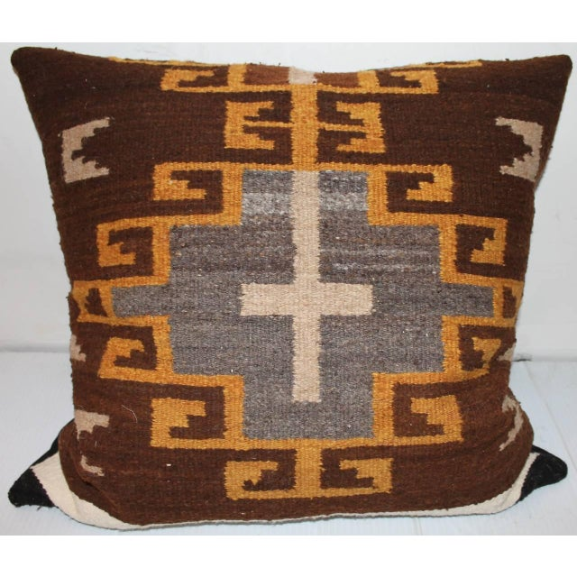 This is most unusual with a cross motif in the center of this weaving. The backing is in a dark brown linen. There are two...