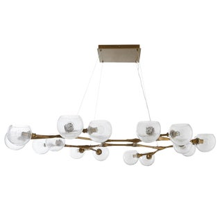 Modern Arteriors Mahowald Antique Brass and Glass Chandelier For Sale