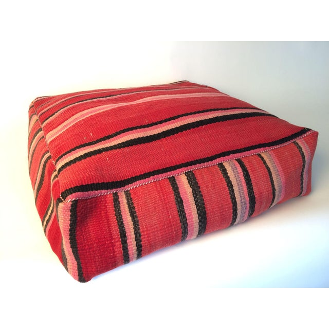 This exquisite Red, Pink and Black stripe wool floor pillow is made from a vintage Moroccan kilim rug. Hand loomed by the...