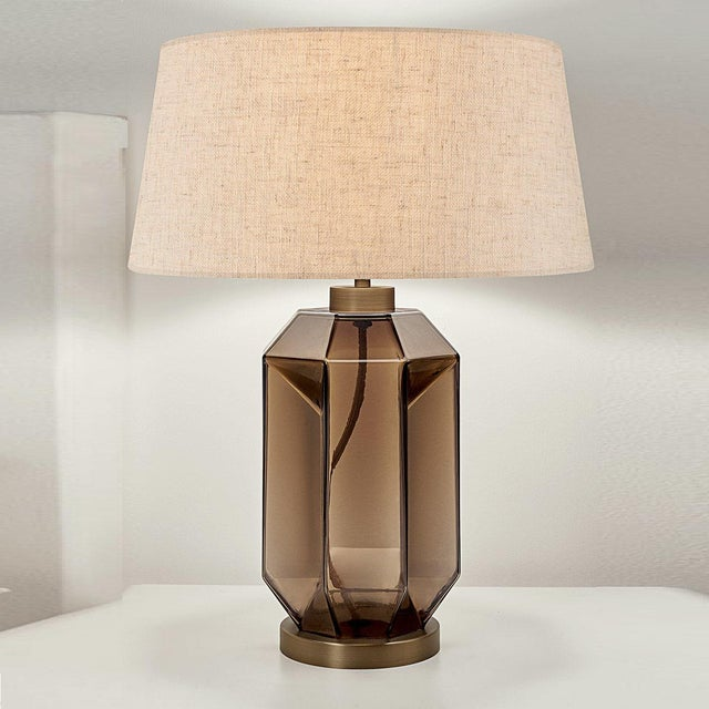 Mocca glass hand blown lamp with a geometric pattern on a golden bronze metal base. Complete with linen shade and gold...