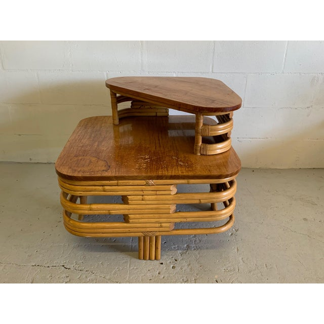 Art Deco two-tiered stacked rattan side table in Paul Frankl style features bent rattan and mahogany top. In good...