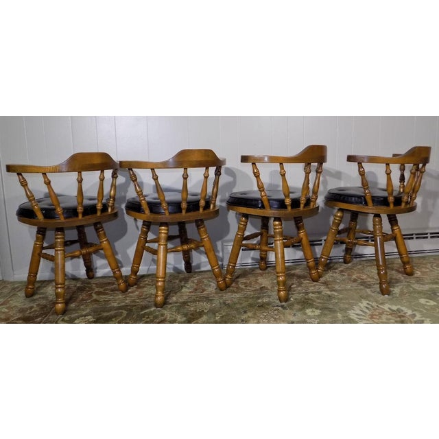 This listing is for one swivel counter stool or chair from George B. Bent of Gardner, Massachusetts. Carpentry is of top...