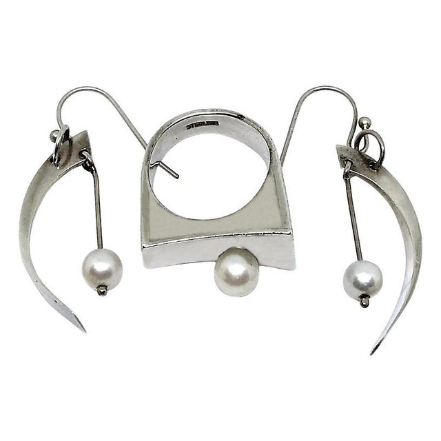 """Modernist sterling silver ring and earrings accented with cultured pearls. Ring size: 6. French-hook back earrings, 1.75""""L..."""