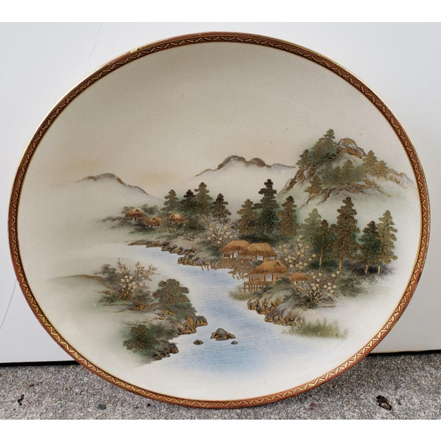 Up for sale is an Early 20th Century Japanese Satsuma Porcelain Mountain Village on River Scene Charger Plate! It measures...